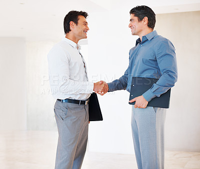 Buy stock photo Successful business men greeting each other in office corridor