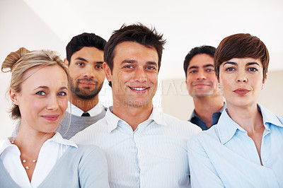 Buy stock photo Successful business man with his supporting team at office