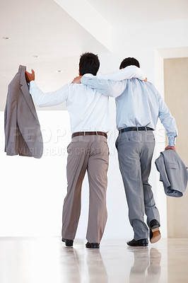 Buy stock photo Rear view of friendly business colleagues walking with arms around