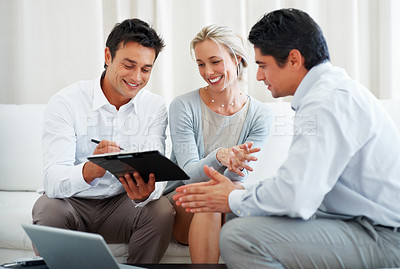 Buy stock photo Happy couple in meeting with business consultant with man signing investment contract
