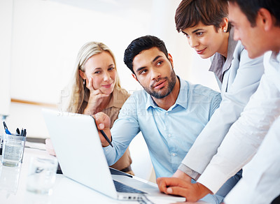 Buy stock photo Business colleagues working together with laptop at desk