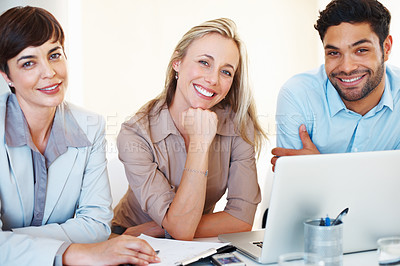 Buy stock photo Portrait of business colleagues sitting at table and smiling