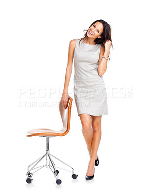 Buy stock photo An attractive young woman standing with a chair isolated on white background
