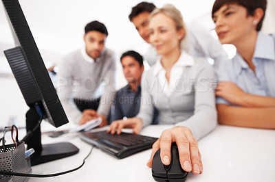 Buy stock photo Focus on business woman's hand using computer mouse during meeting
