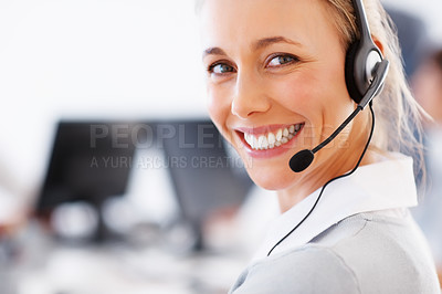Buy stock photo Closeup of a beautiful business woman wearing headset and smiling at you - copyspace