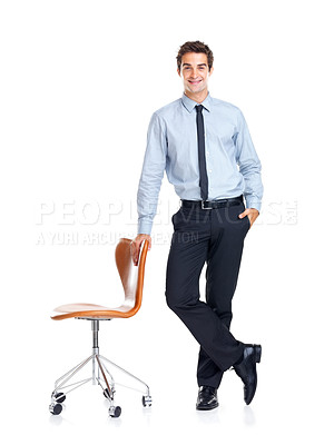 Buy stock photo Attractive male executive standing with a chair on white background