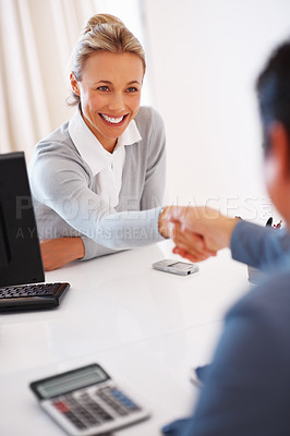 Buy stock photo Smiling business woman shaking hands with male partner