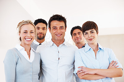 Buy stock photo Portrait of confident male leader with his supporting team