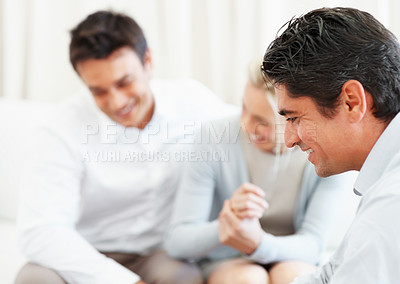 Buy stock photo Closeup of business consultant with couple in background
