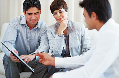 Buy stock photo Financial advisor explaining contract details to couple