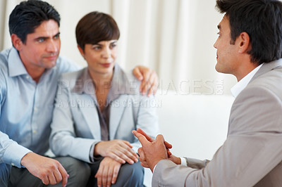 Buy stock photo Financial consultant in discussion with business couple during meeting