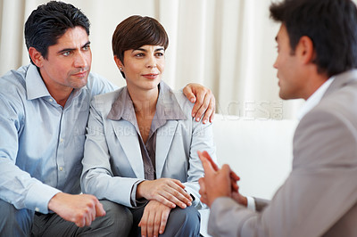Buy stock photo Happy business couple clearing their doubts with financial consultant during meeting