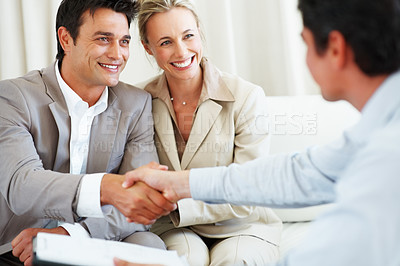 Buy stock photo Happy business couple with the man and financial consultant shaking hands during meeting