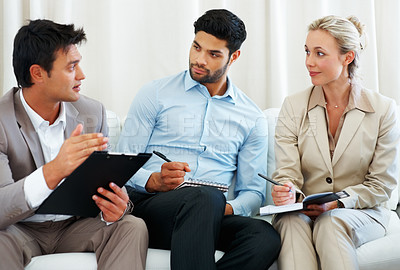 Buy stock photo Smart business man in discussion with colleagues