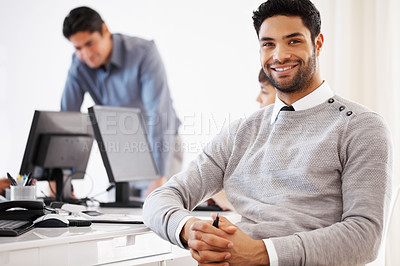Buy stock photo Confident business man sitting at table with colleagues in background