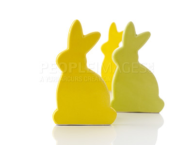 Buy stock photo Image of three yellow colored easter bunnies isolated on white background