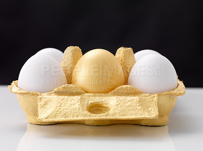 Buy stock photo Easter eggs in a container on a shiny white table against black background
