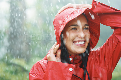 Buy stock photo Pretty woman smiling in the rain