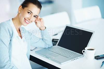 Buy stock photo Confident businesswoman sitting smiling at you in front of laptop with coffee and cell phone near by - copyspace