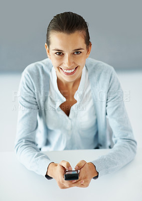 Buy stock photo View of beautiful smiling woman texting