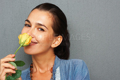 Buy stock photo Smiling woman smelling flower