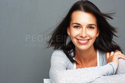 Buy stock photo Beautiful woman with windswept hair leaning on shelf