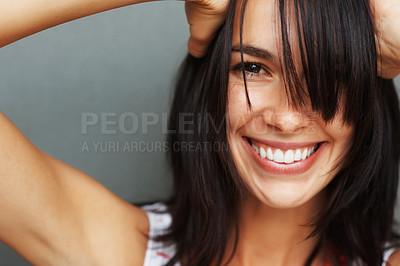 Buy stock photo Pretty woman holding hands on head and smiling with unkept hair