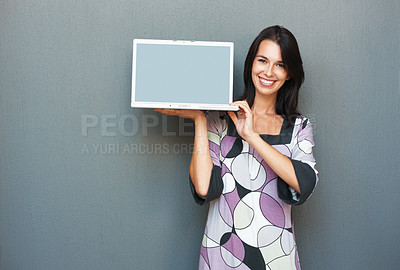 Buy stock photo Pretty young woman holding up laptop showing the screen