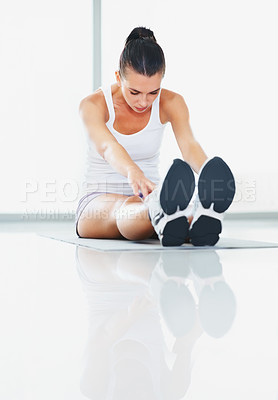 Buy stock photo Woman in sitting position doing stretching exercise