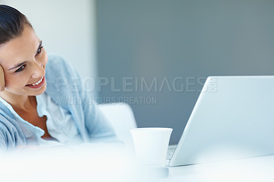 Buy stock photo Portrait of smiling woman relaxing while looking at laptop