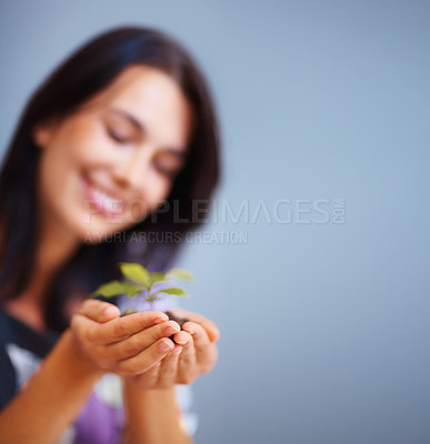 Buy stock photo Happy woman holding plant on colored background - copyspace