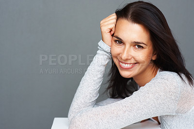 Buy stock photo Closeup portrait of happy young woman smiling on grey background