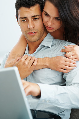Buy stock photo Portrait of serious young couple working on laptop