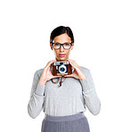 Young woman holding an old camera on white