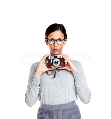 Buy stock photo Attractive young woman wearing glasses holding a camera against white background