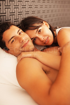 Buy stock photo Portrait of cute couple lying in bed and smiling