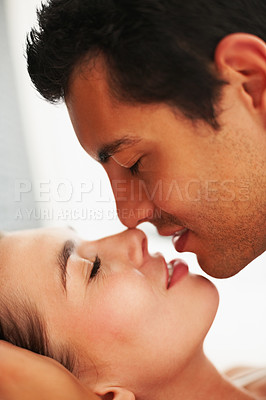 Buy stock photo Side view of young couple in romantic mood