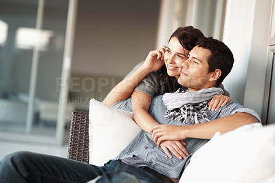 Buy stock photo Portrait of young couple relaxing at living room