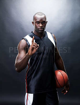 Buy stock photo Potrait of a confident young male basketball player looking with an attitude against grunge background