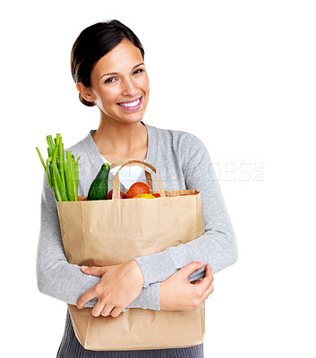 Buy stock photo Portrait of happy woman holding a paper shopping bag full of fresh groceries on white background