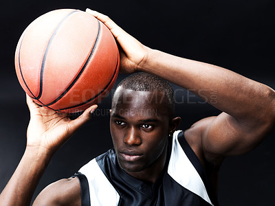 Buy stock photo Portrait of a confident young male basketball player preparing for a penalty shot against grunge background