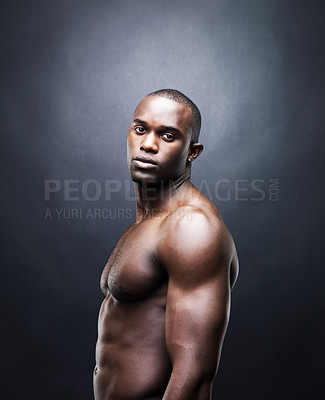 Buy stock photo Portrait of a shirtless young man looking at you with an attitude against grunge background
