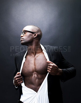 Buy stock photo Portrait of a young business man showing off his body against grunge background