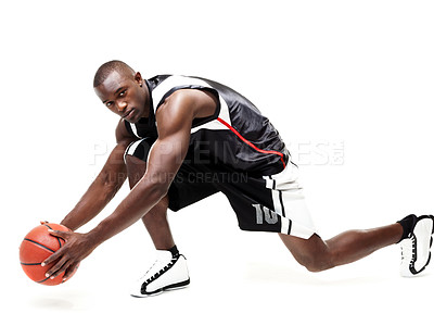 Buy stock photo Portrait of a young male basketball player in action isolated on white background