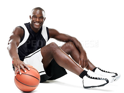 Buy stock photo Portrait of a young black african man sitting with basketball over white isolated background