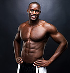 Happy bodybuilder with muscular physique