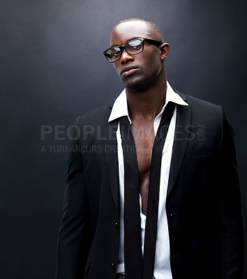 Buy stock photo Portrait of a sexy black man with open shirt and tie standing against dark background