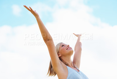 Buy stock photo Happy female with arms raised towards the sky