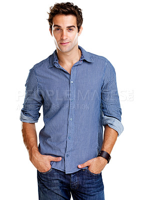 Buy stock photo Portrait of a handsome young man standing with his hands in his pockets against a white background