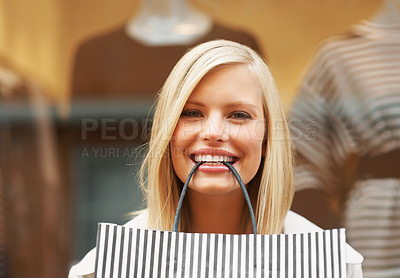 Buy stock photo Closeup of pretty woman with shopping bag in smiling mouth